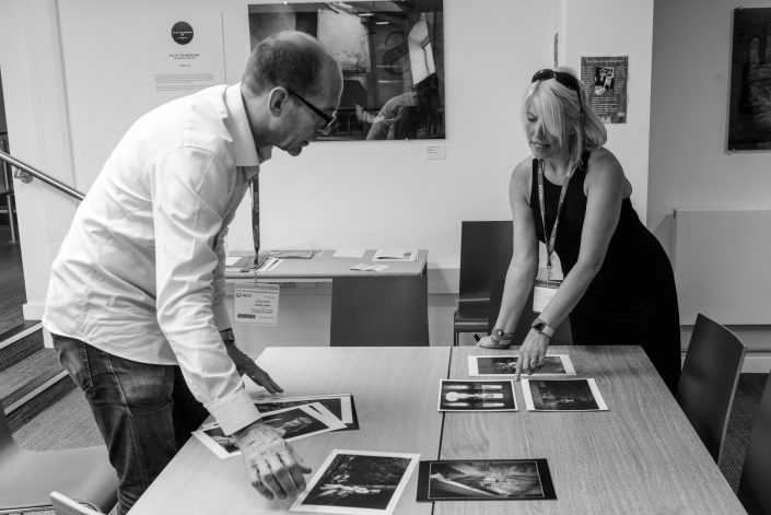 Before the judging commences, MPA President Richard Bradbury FMPA and Chairlady Karen Massey sort the prints into their respective categories. — with Karen Massey at Warwickshire College.